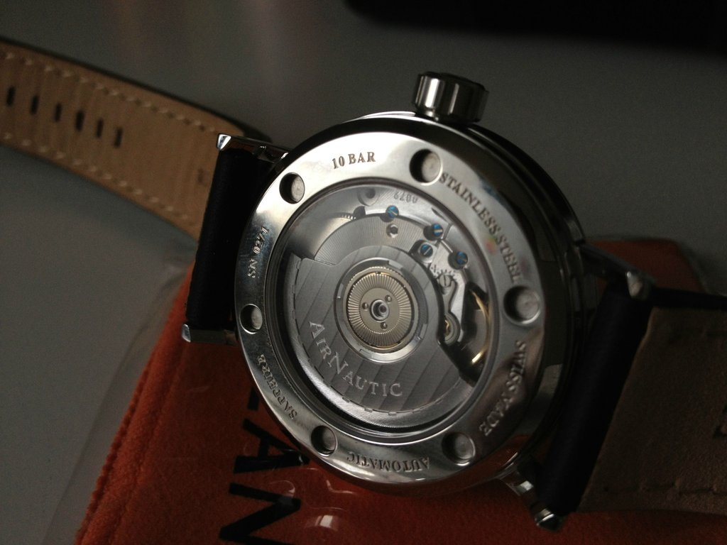 The watch sports blued screws and engraved rotor with Geneva Waves pattern (a COSC feature)
